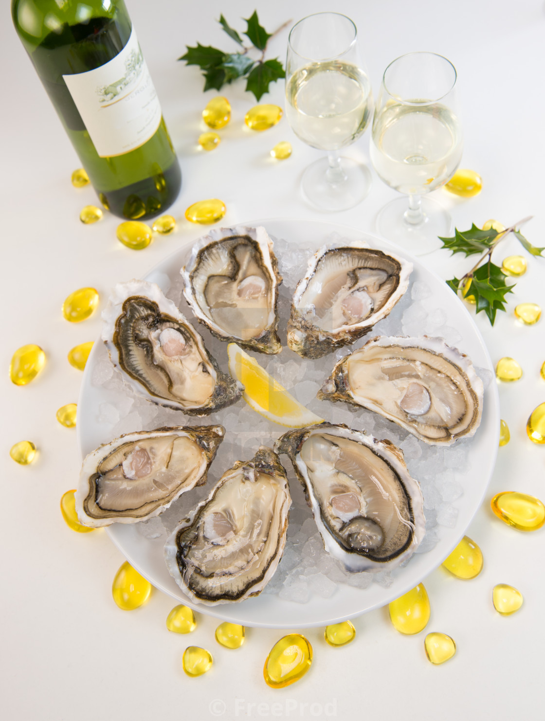 """Oysters on ice and with a piece of lemon and wine"" stock image"