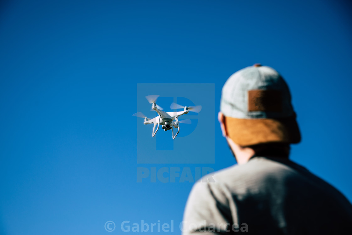 """""""Man playing with drone on the open field"""" stock image"""