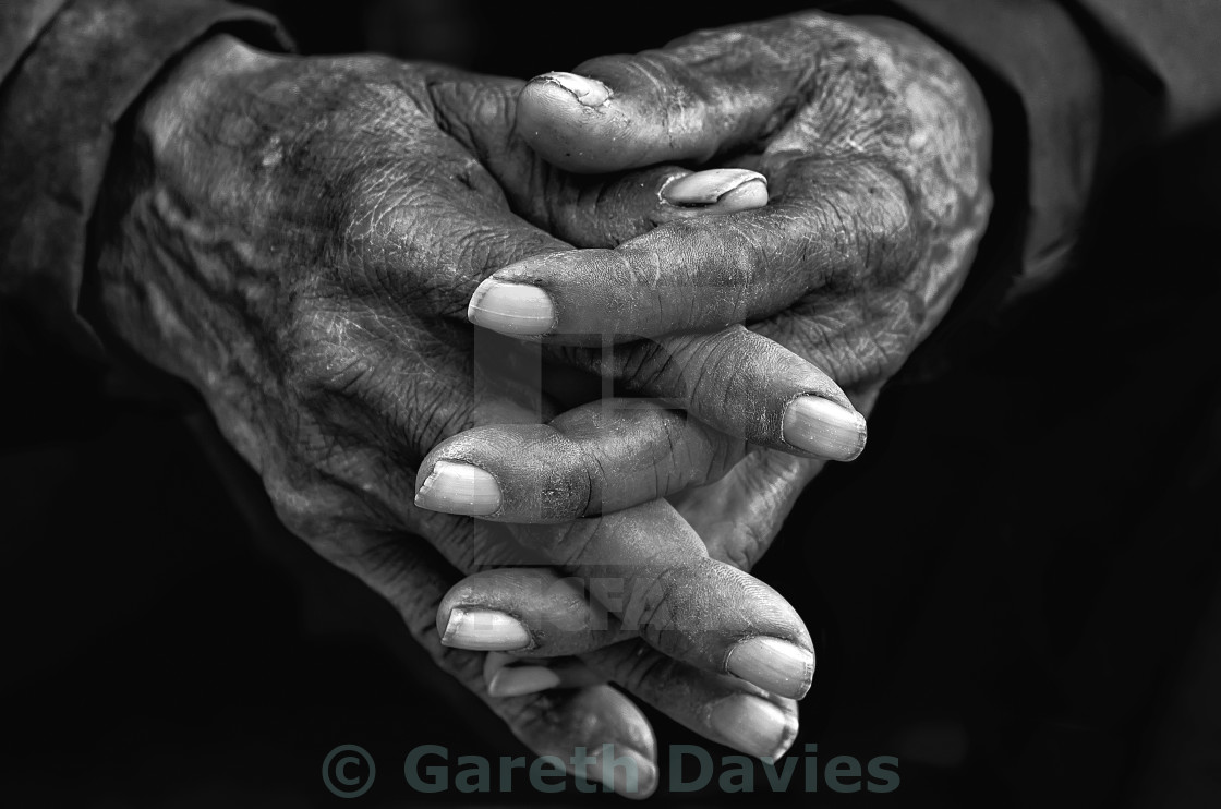 """A pair of hands of an elderly gentleman together in black and white"" stock image"