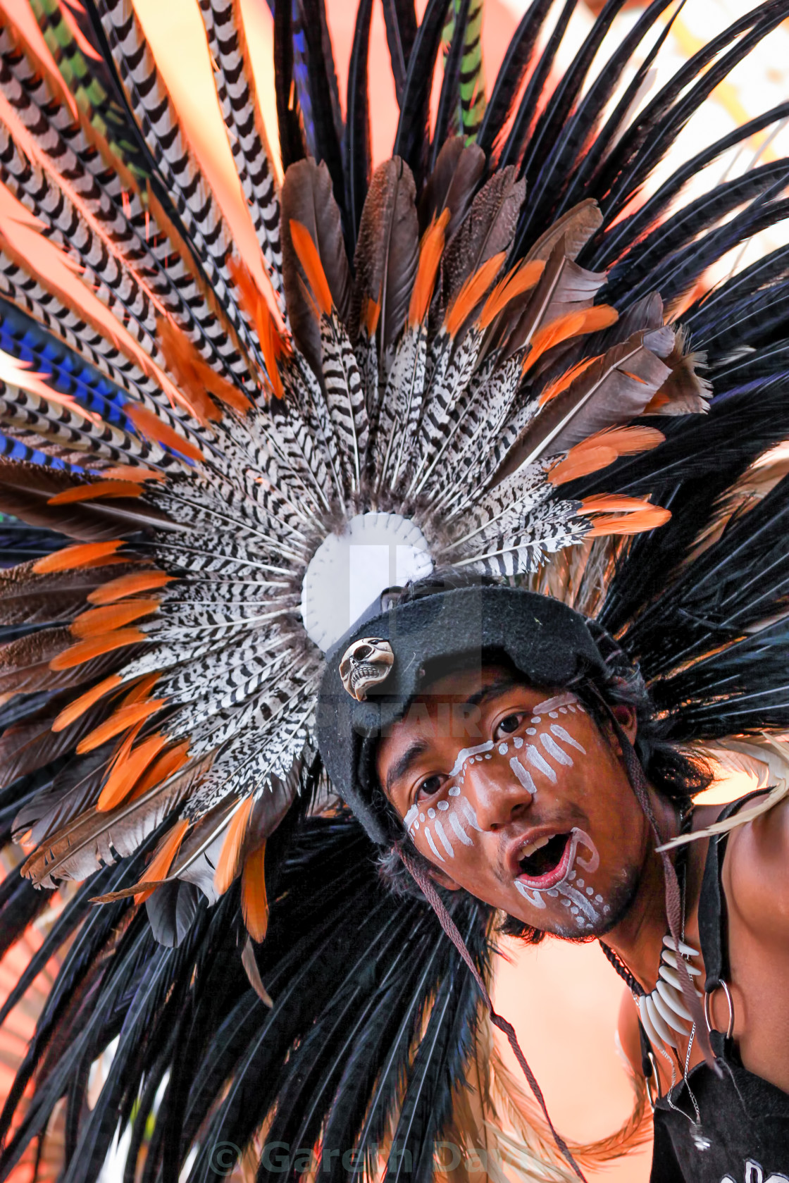 """A young boy wearing a colourful feathered headdress in Mexico"" stock image"