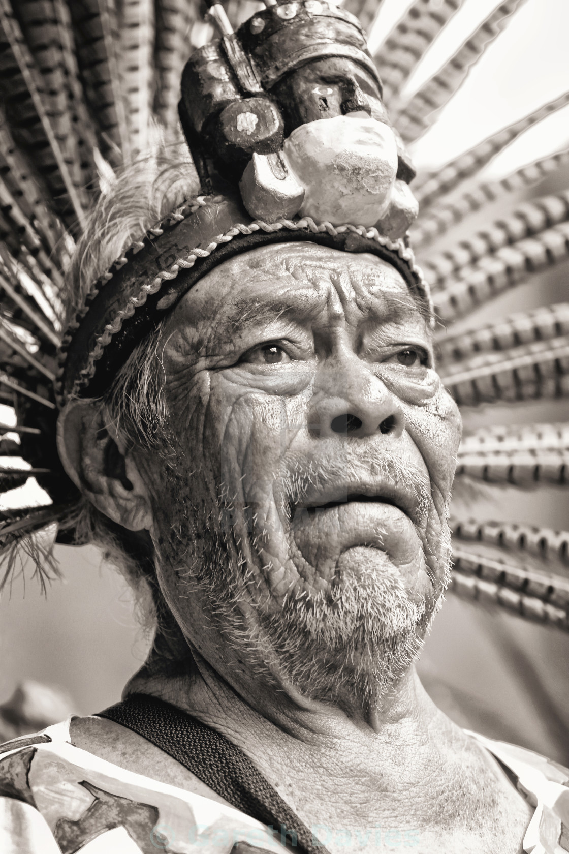 """An elderly man dressed in traditional clothing wearing a headdress at a cultural ceremony in mexico"" stock image"