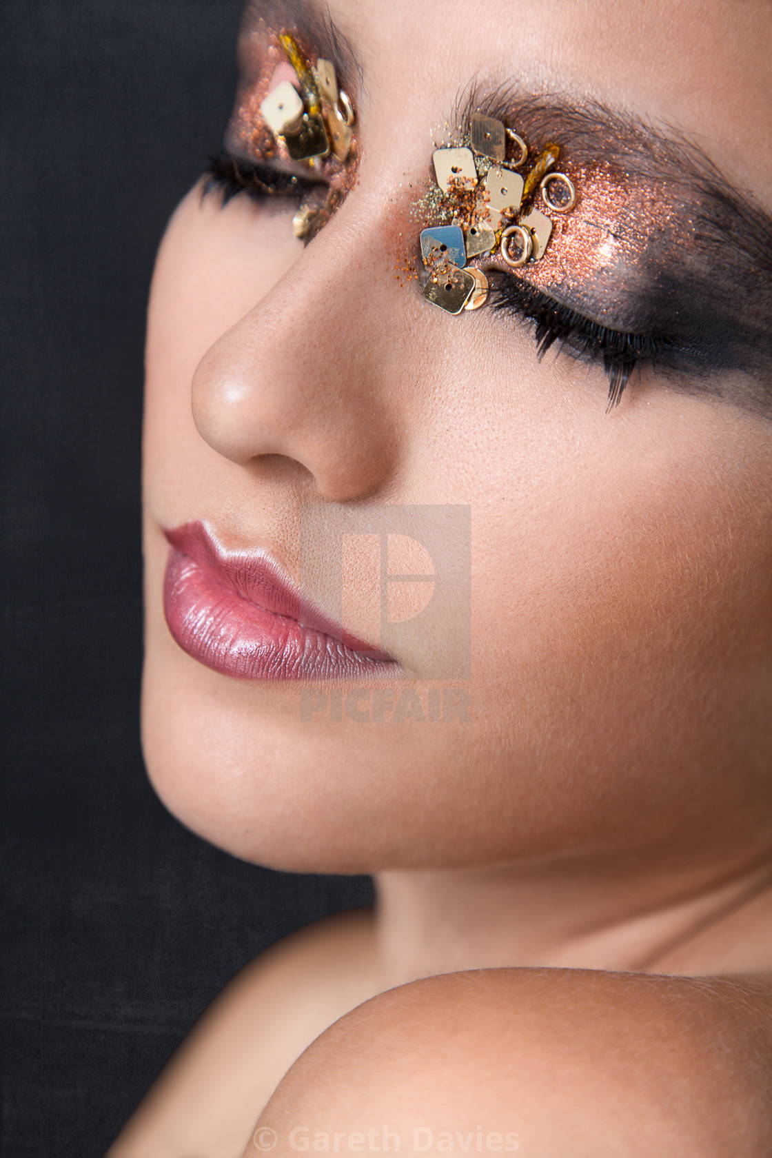 """""""Head shot of a beauty model with extravagant make up"""" stock image"""