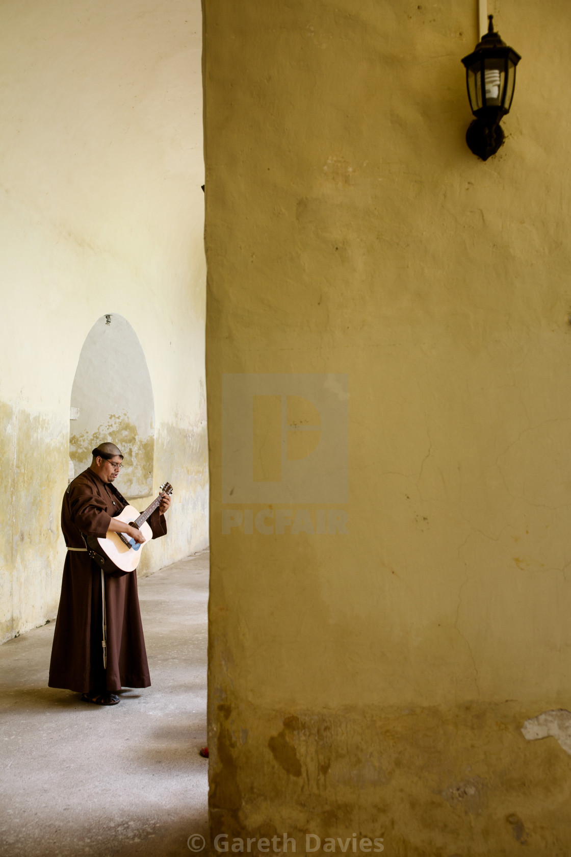 """A franciscan monk plays the guitar in a monastery"" stock image"