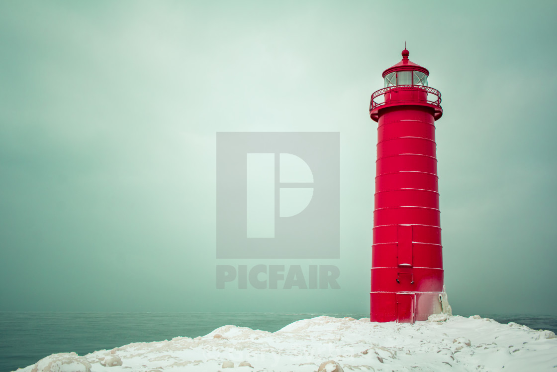 """Winter day at the Grand Haven Lighthouse"" stock image"