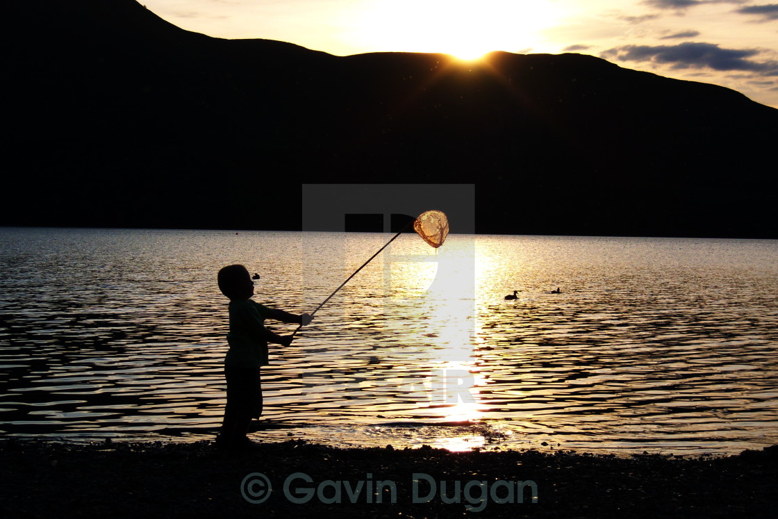 """Playing by the lake"" stock image"
