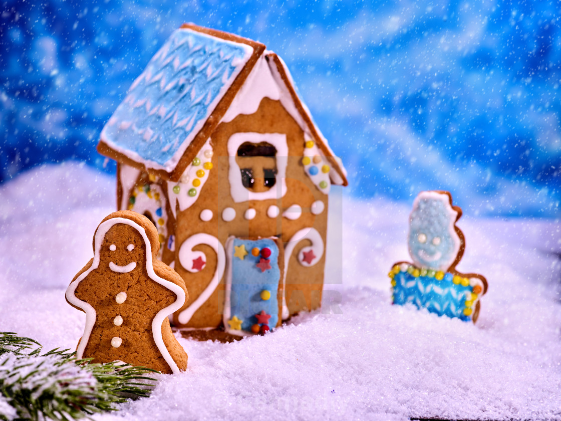 Christmas Gingerbread House Background.Christmas Gingerbread House In Snow On Blue Background
