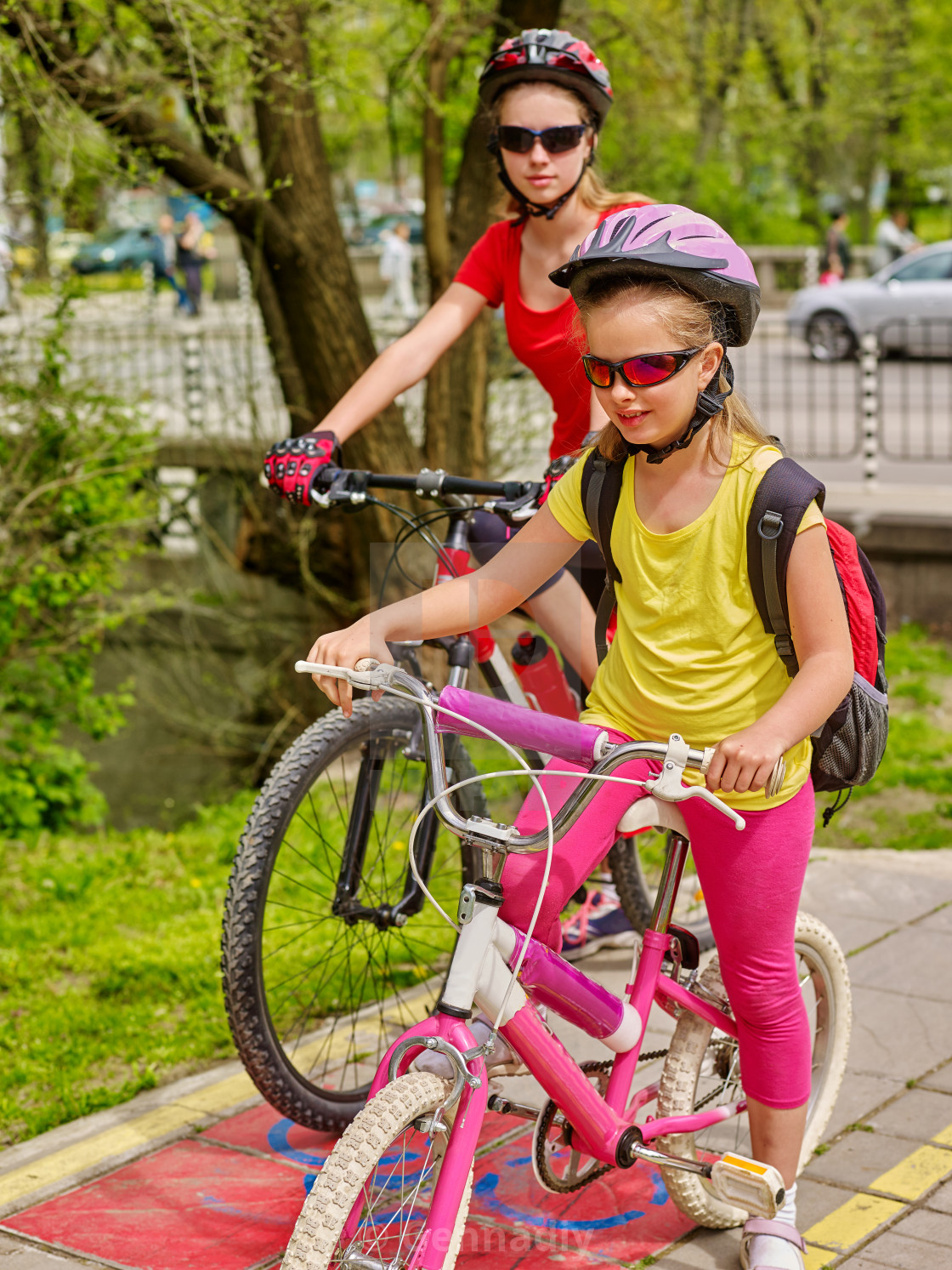 """Family bike ride. Family wearing bicycle helmet with rucksack ."" stock image"