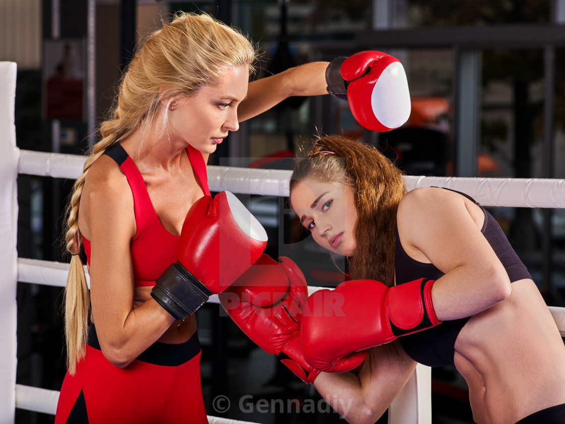 a1219f706 Two boxing women workout in fitness class. - License, download or ...