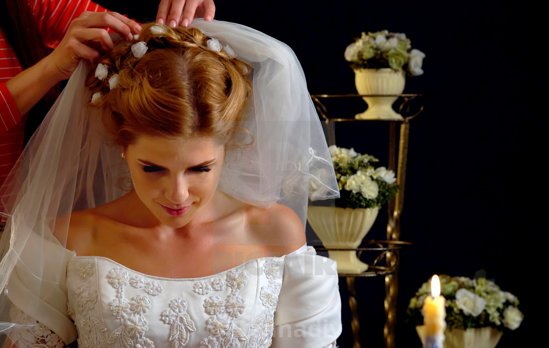 """""""Bride thinking about choice of groom. Woman in wedding dress."""" stock image"""