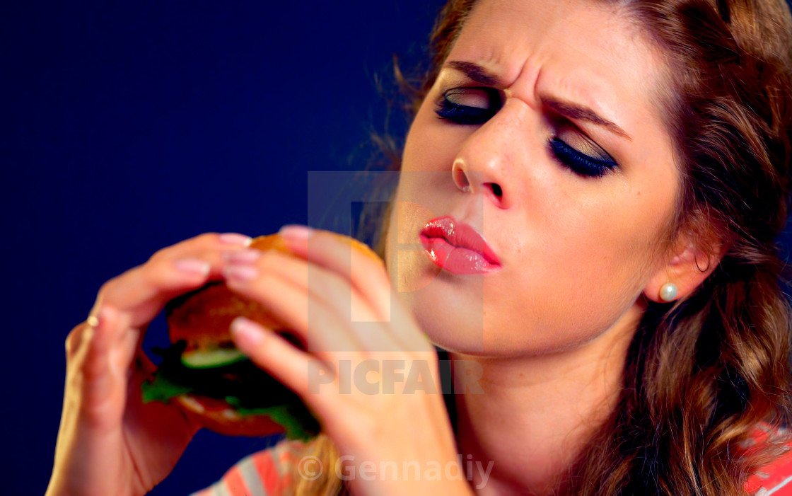"""Woman bite hamburger fast food."" stock image"