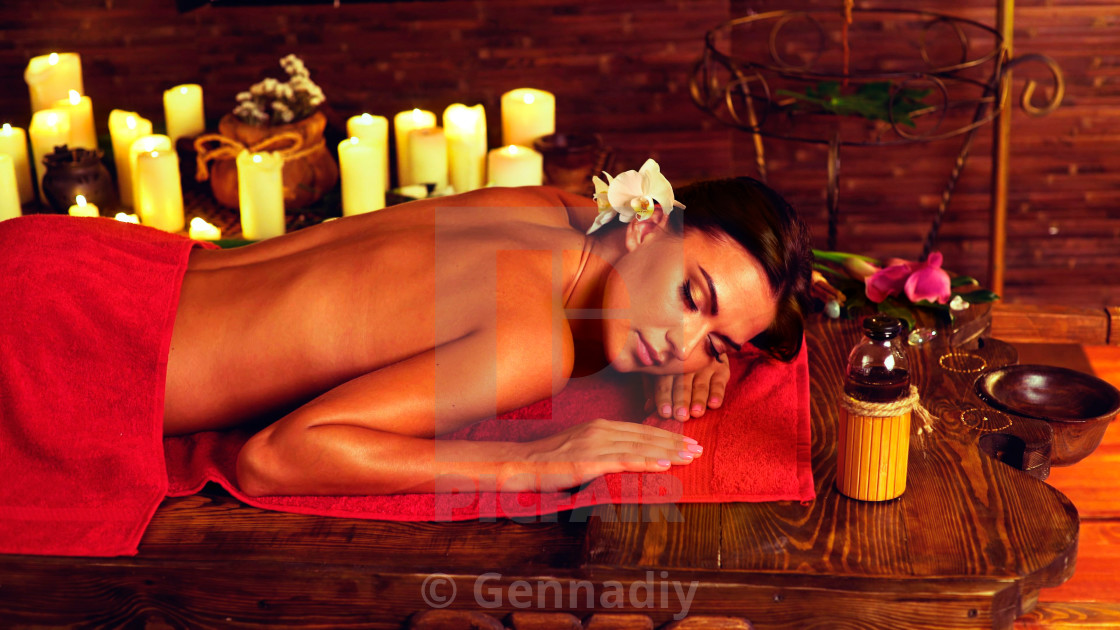 """""""Massage of woman in spa salon. Luxary interior oriental therapy."""" stock image"""