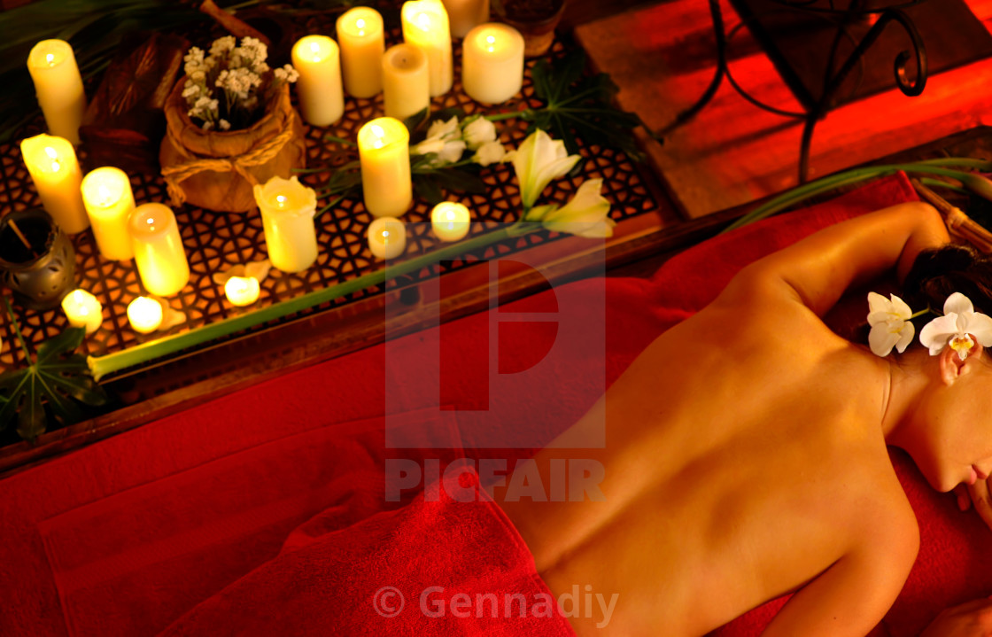 """""""Massage of woman in spa salon. Luxary interior oriental therapy ."""" stock image"""
