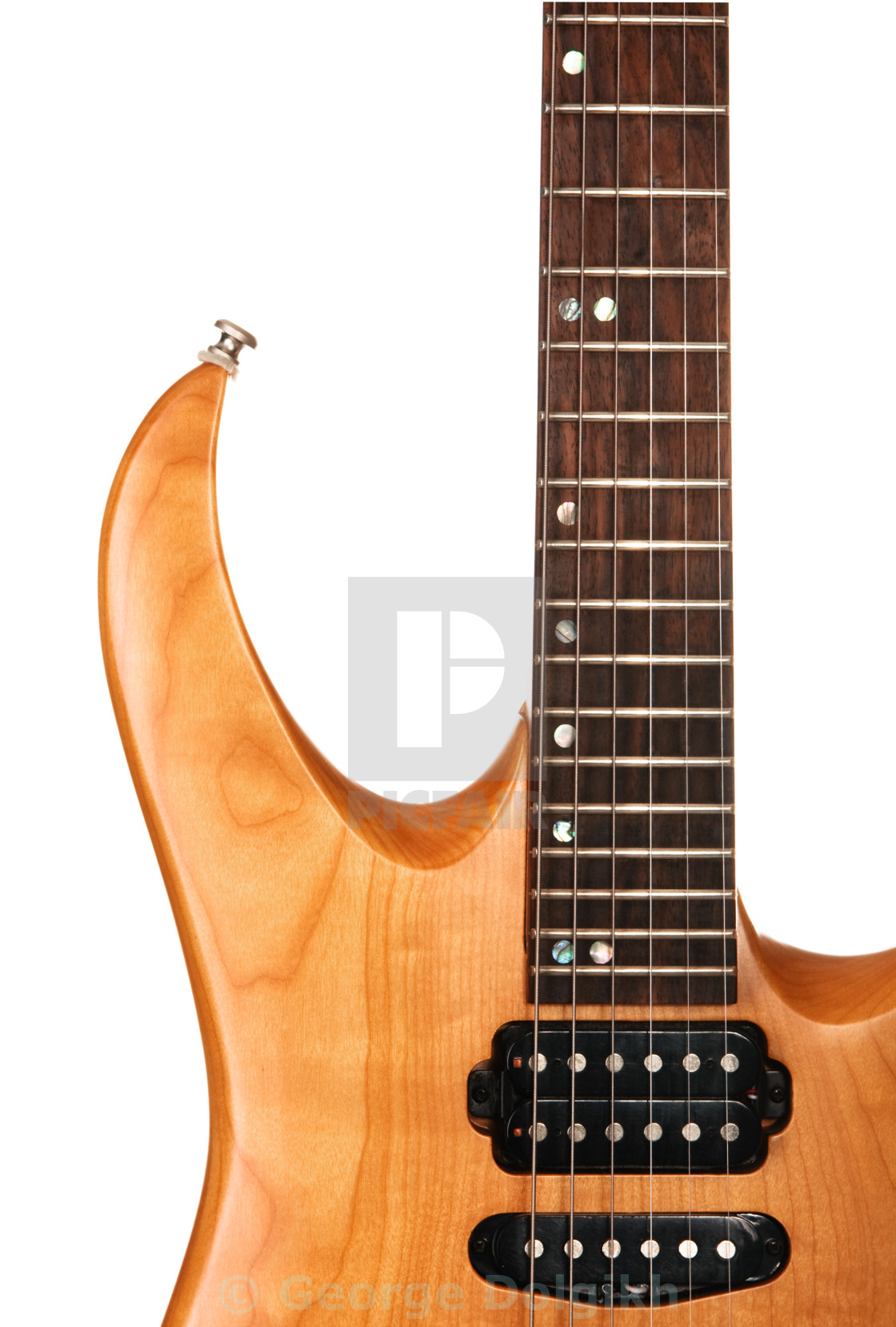 """Toned maple electric guitar closeup"" stock image"