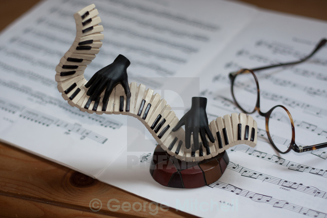 """""""Piano keyboard, sheet music with spectacles"""" stock image"""