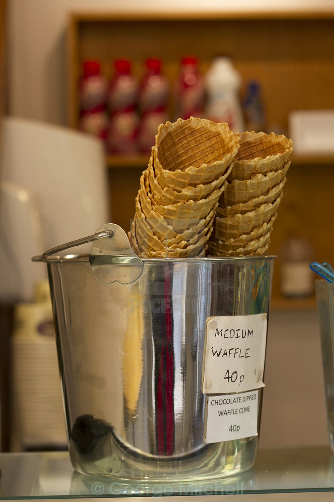"""Ice Cream cones at an Ice Cream Parlour"" stock image"