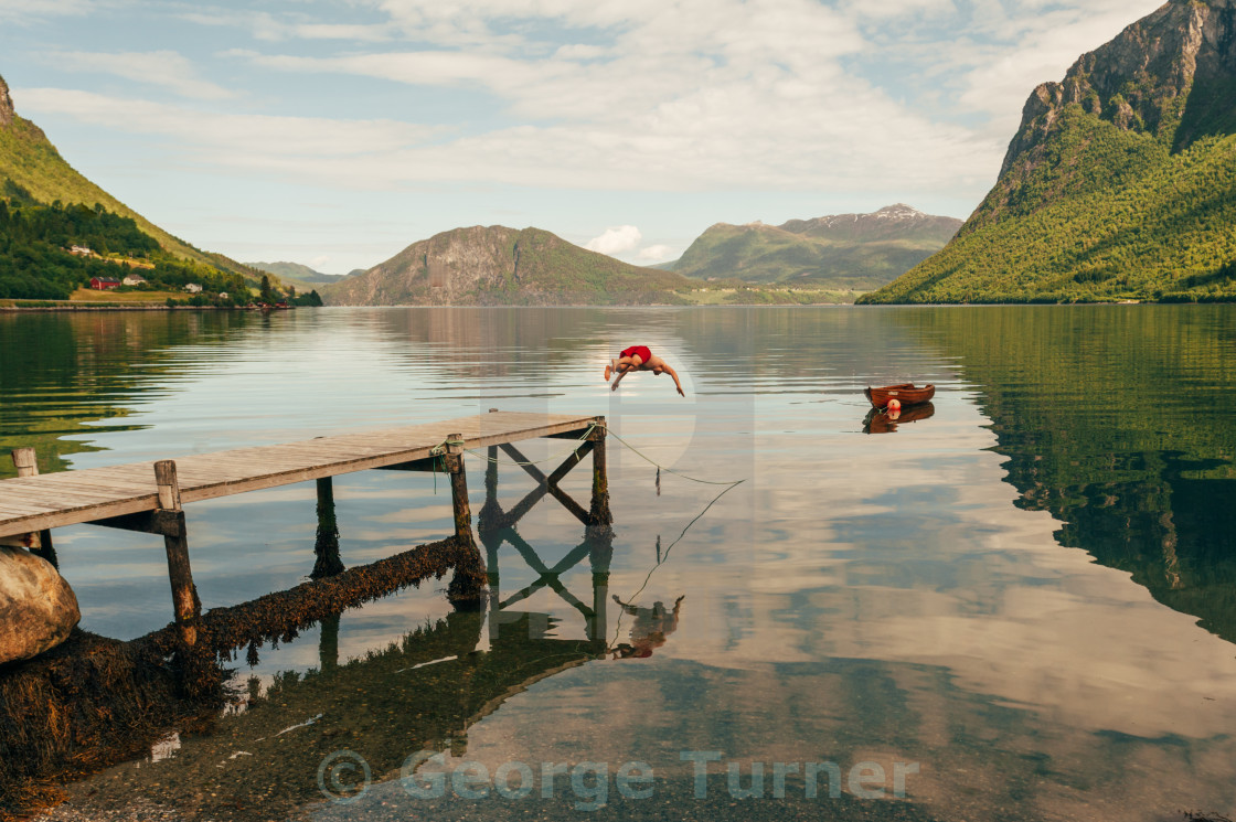 """Diving into Norway's fjords"" stock image"