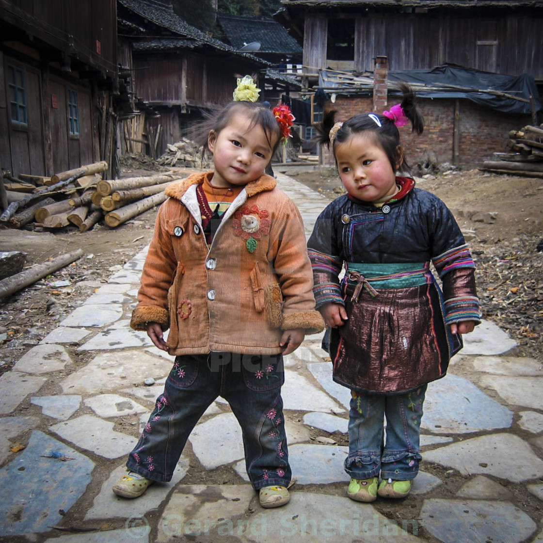 """Two cute kids in rural China"" stock image"