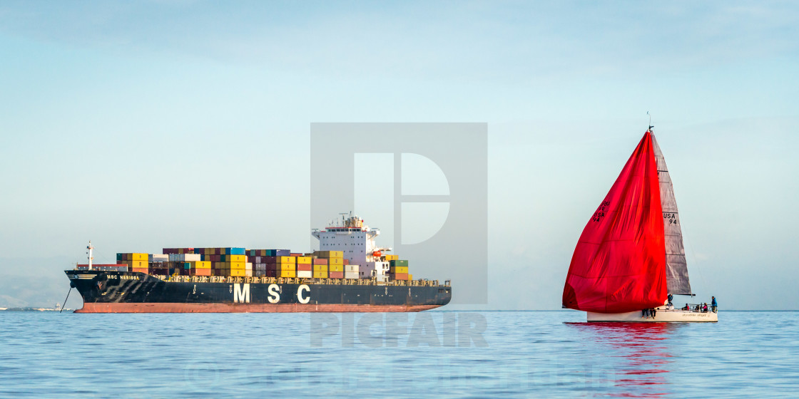 """Container Ship and Red Spinnaker"" stock image"