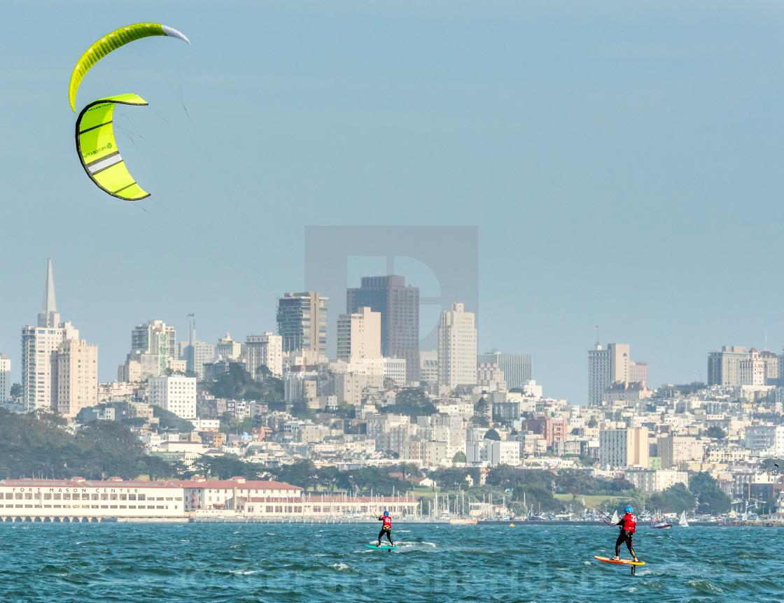 """Foiling Kiteboarders race across San Francisco Bay"" stock image"