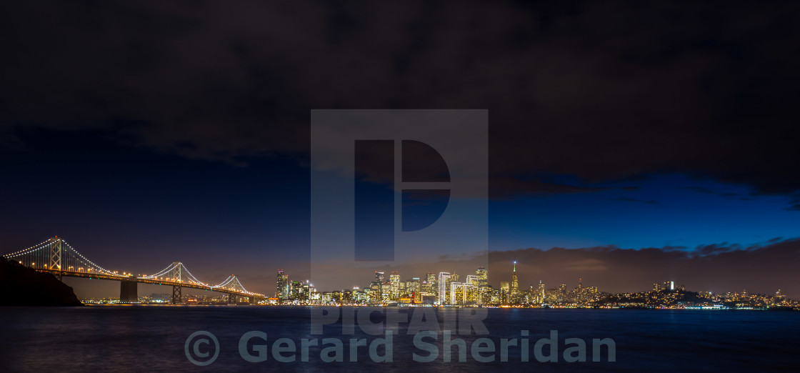 """San Francisco Skyline and Bay Bridge at Night"" stock image"