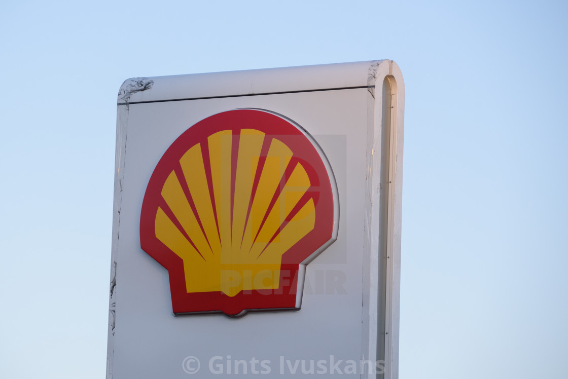 """""""02.04.2019. RIGA, LATVIA. Logo of Shell oil company on gas station. Shell is United States-based wholly owned subsidiary of Royal Dutch Shell."""" stock image"""
