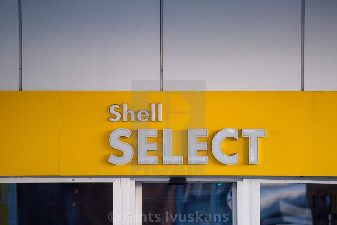 """02.04.2019. RIGA, LATVIA. Logo of Shell oil company on gas station. Shell is United States-based wholly owned subsidiary of Royal Dutch Shell."" stock image"