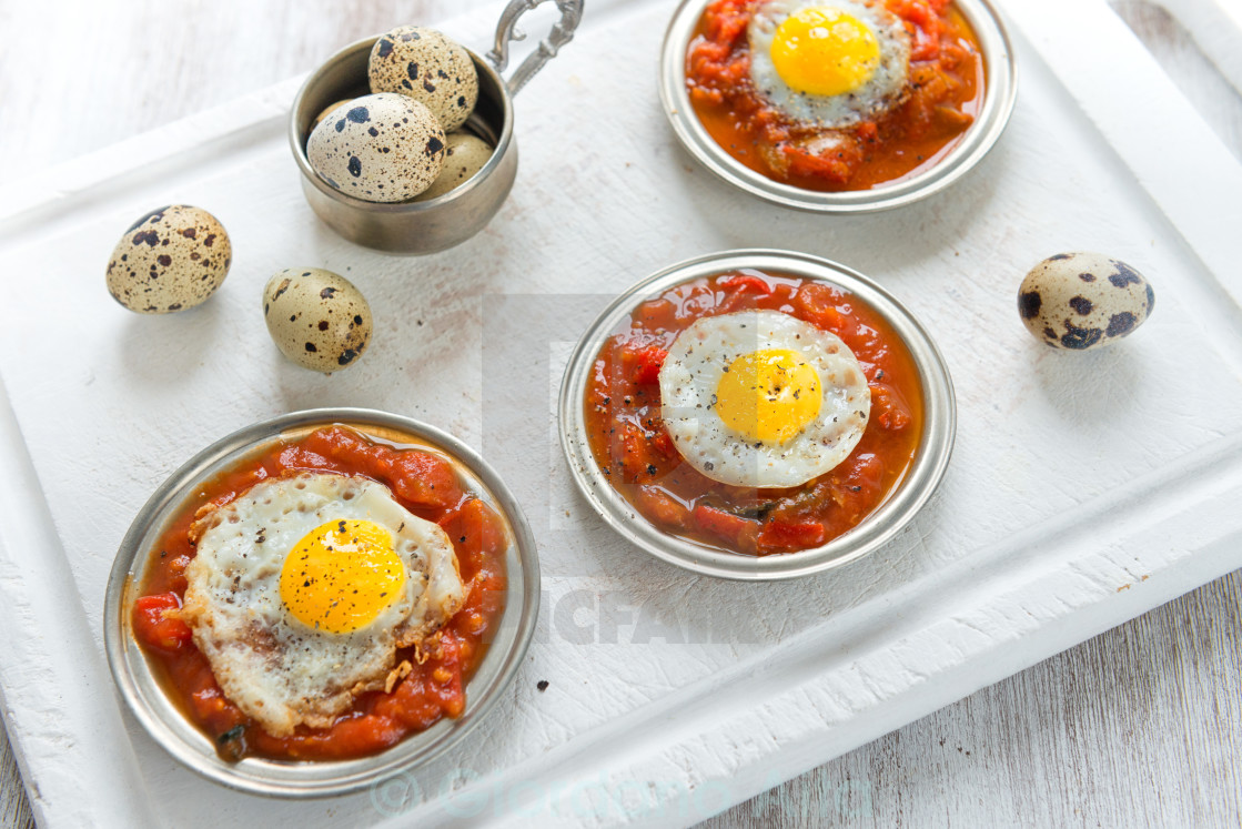 """""""Omelette of quail eggs with tomato sauce"""" stock image"""