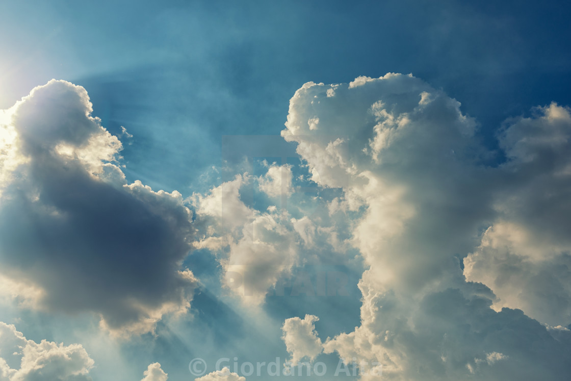 """The clouds and the sun"" stock image"