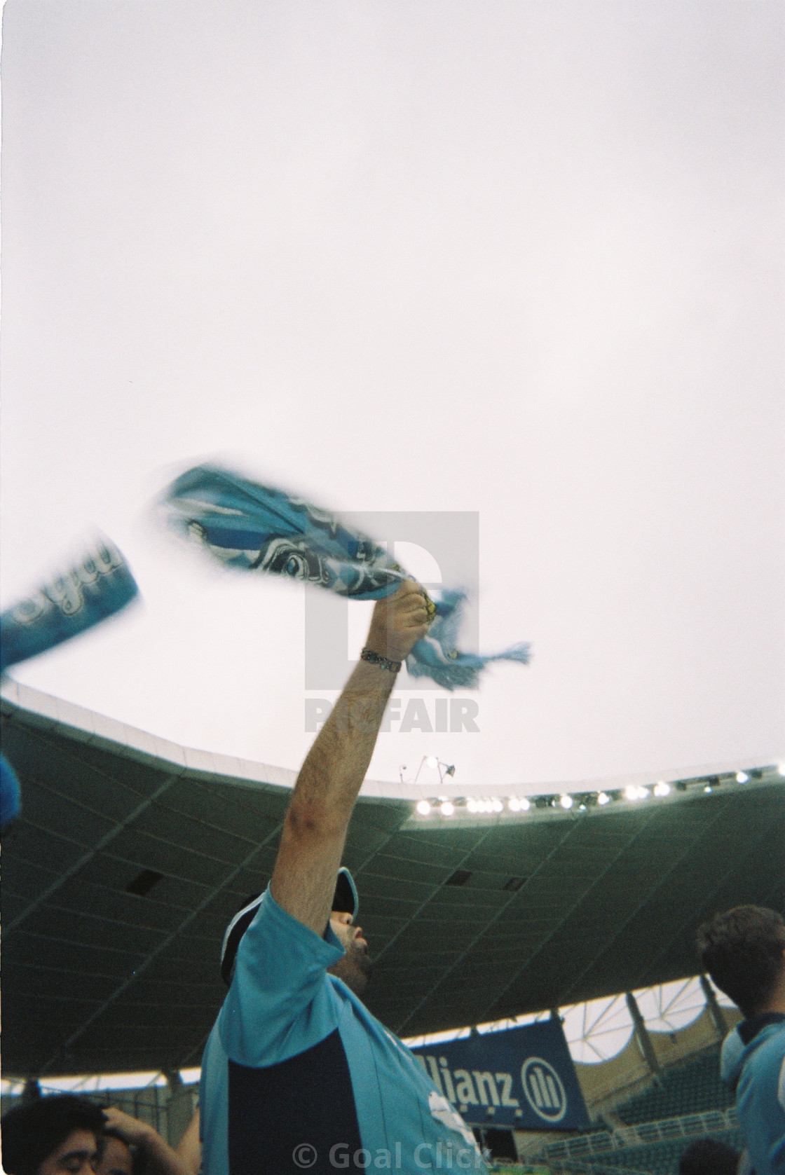 """Football fan waving scarf"" stock image"