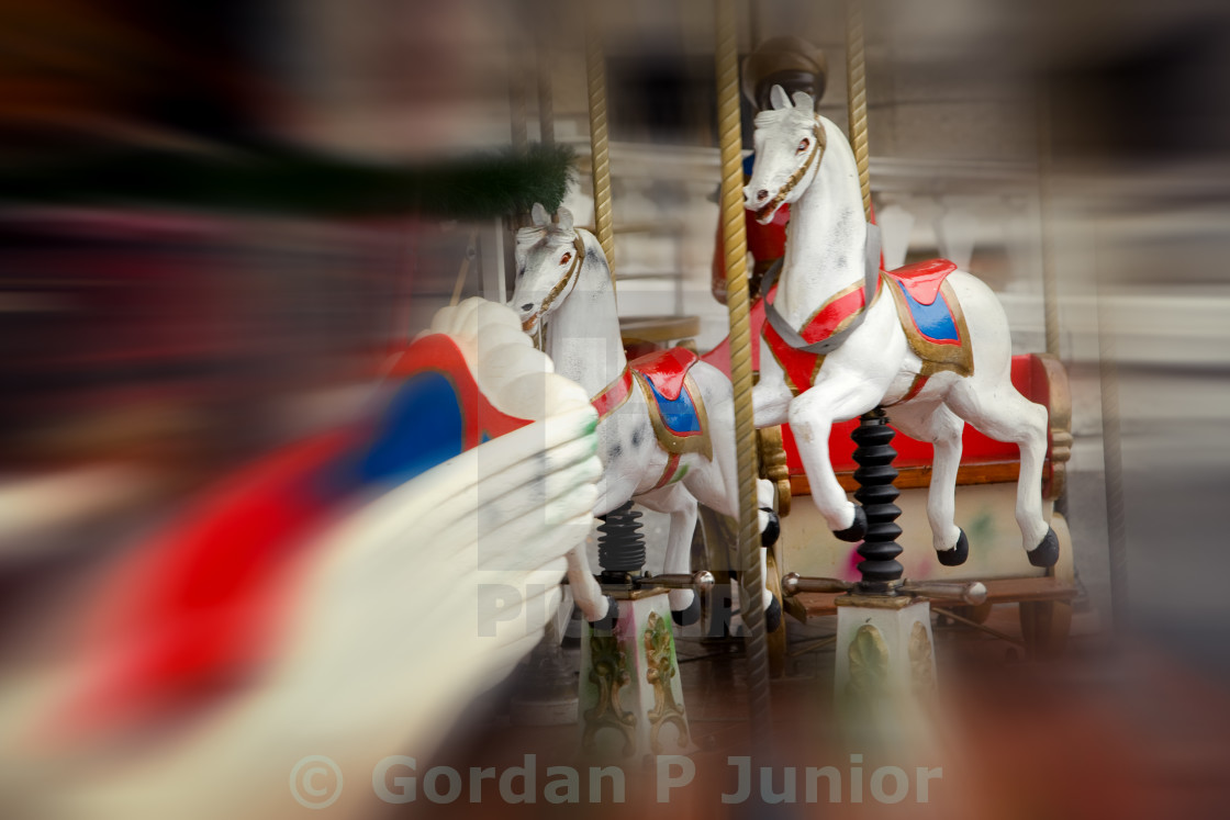 """""""Vintage carousel in motion"""" stock image"""