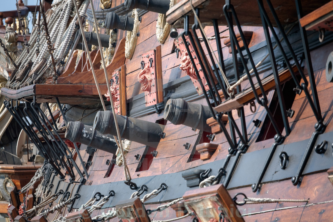"""Old pirate ship cannons"" stock image"