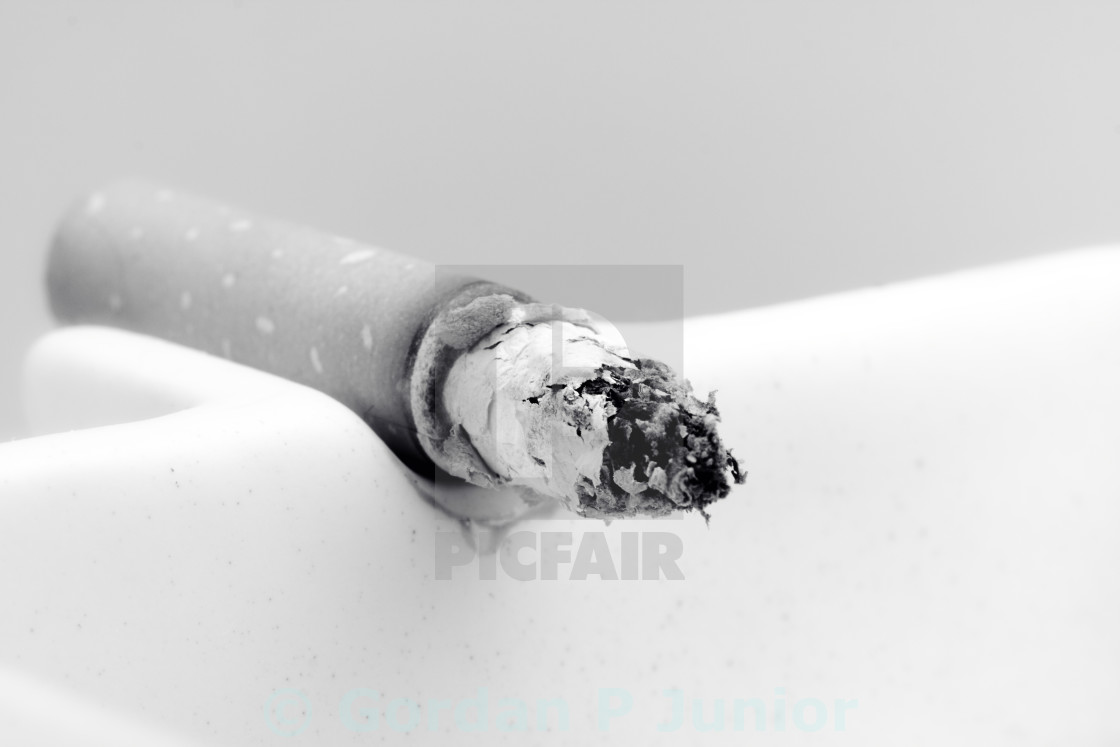 """A burning cigarette"" stock image"
