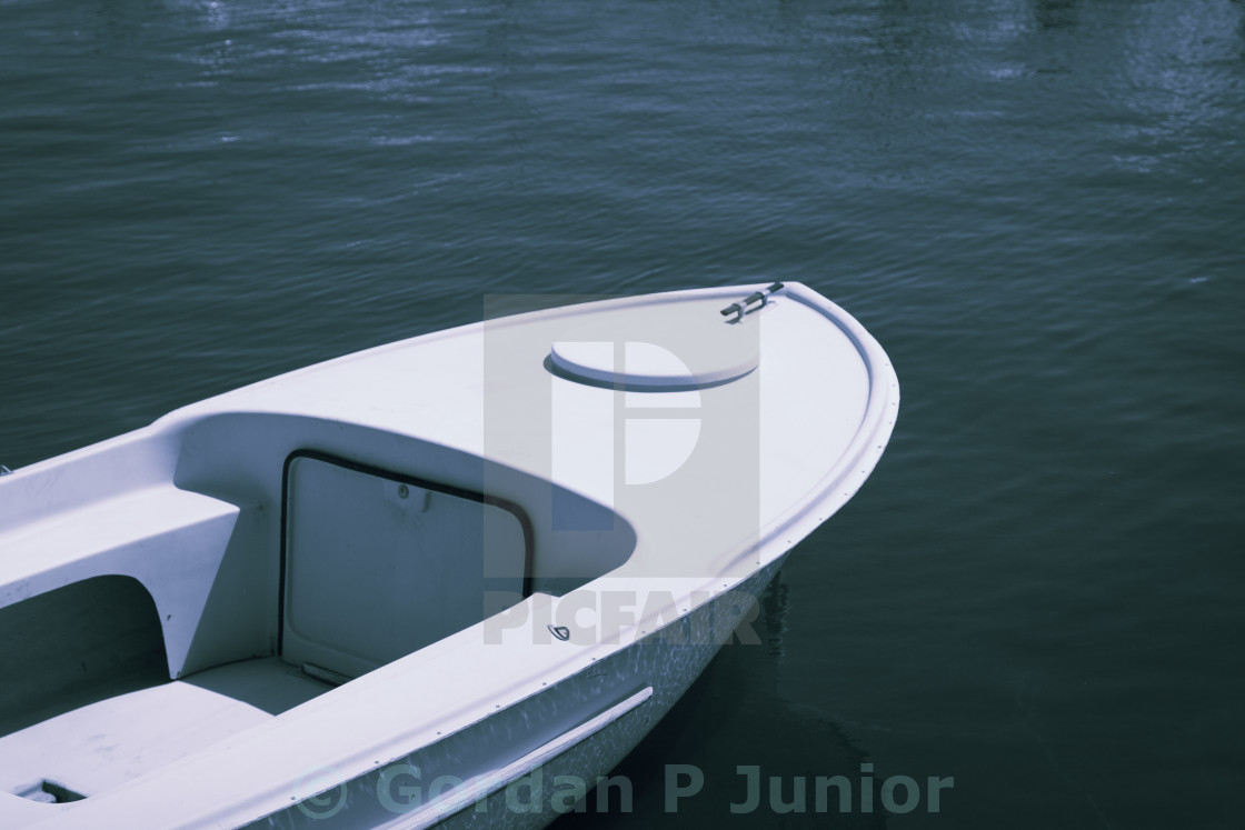 """Old plastic small fishing boat in good condition"" stock image"