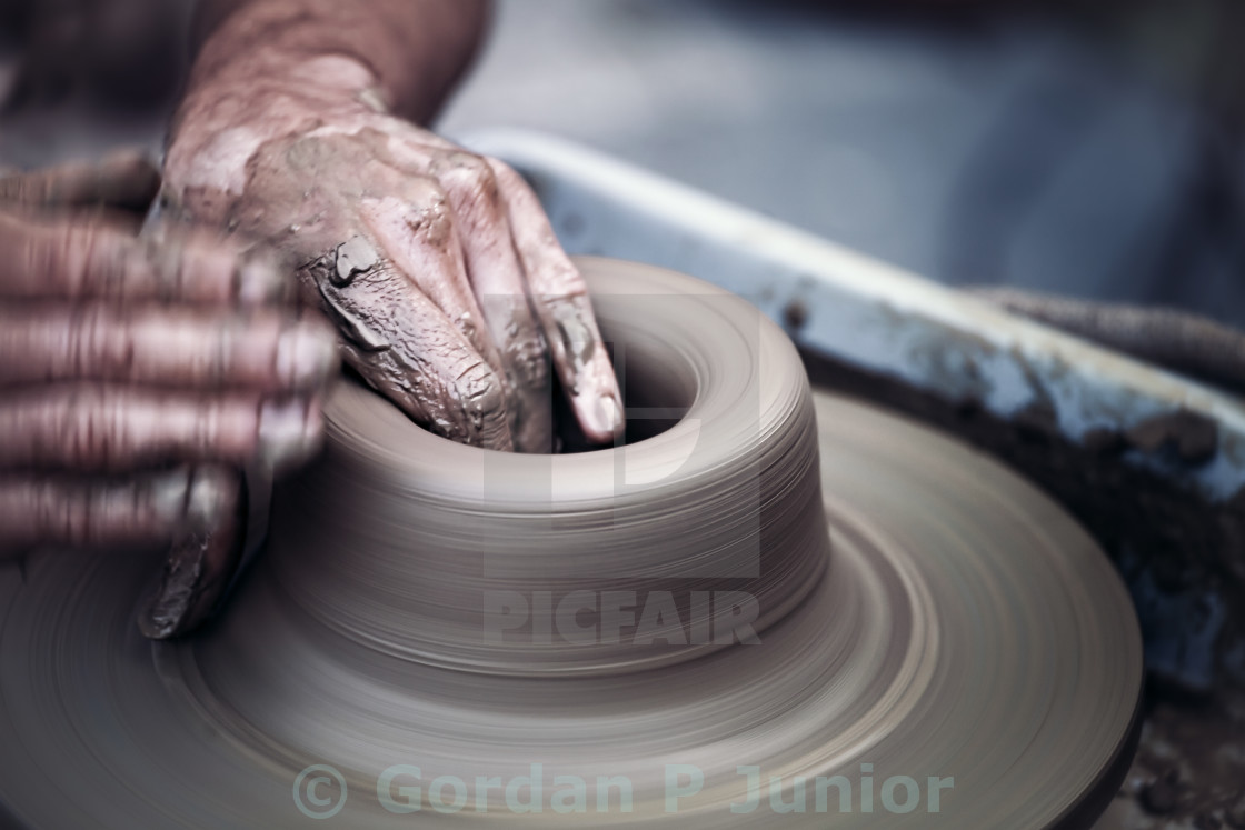 """""""Hands working on pottery wheel , artistic toned"""" stock image"""