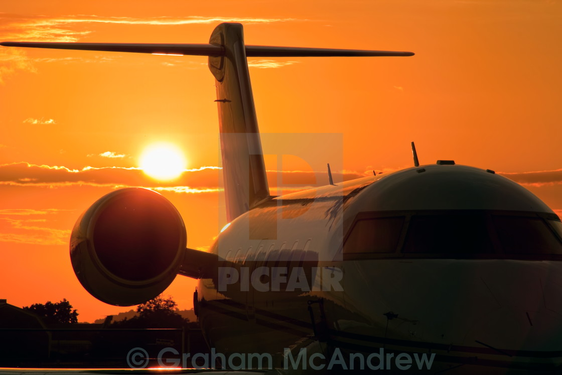 """corporate jet sunset"" stock image"