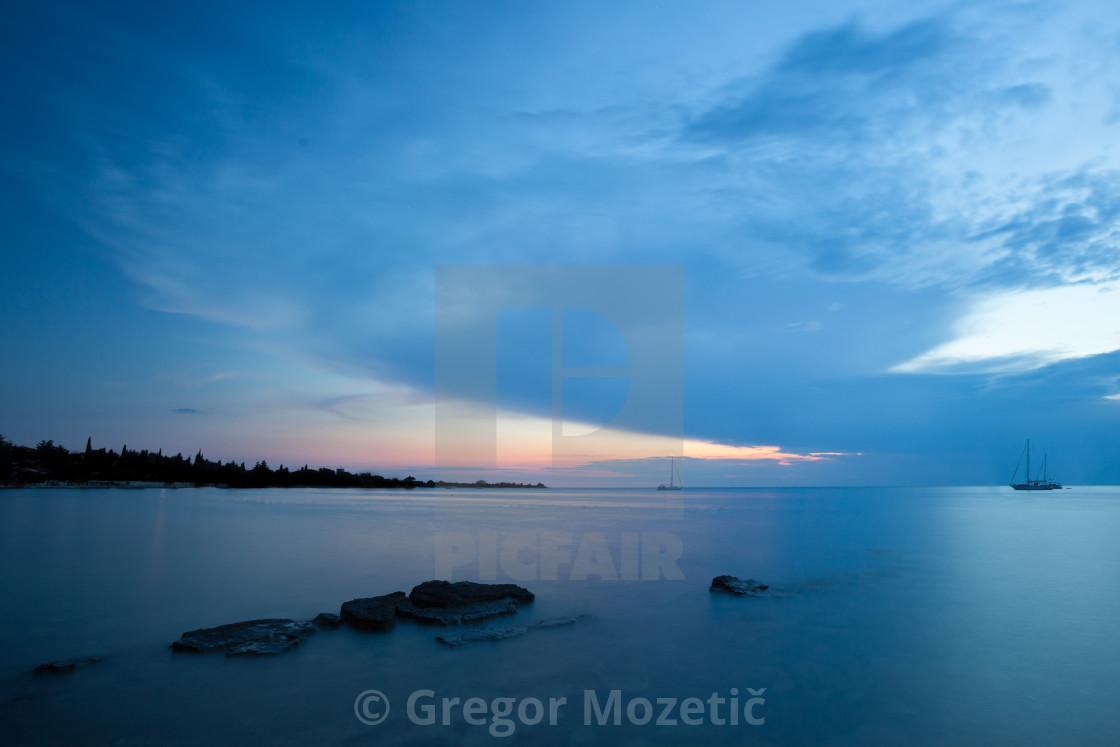 """Beautiful cloudscape over the sea, sunset shot"" stock image"