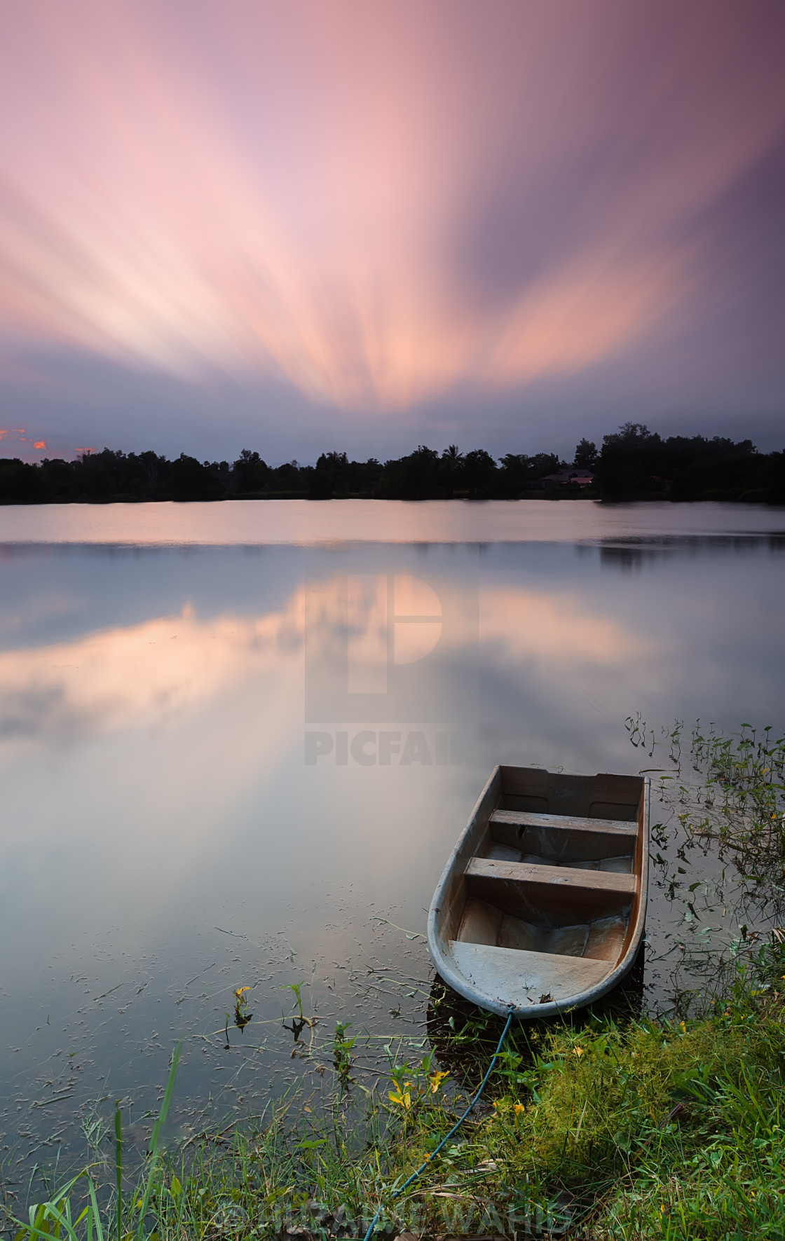 """""""Boat on a lake during sunset"""" stock image"""