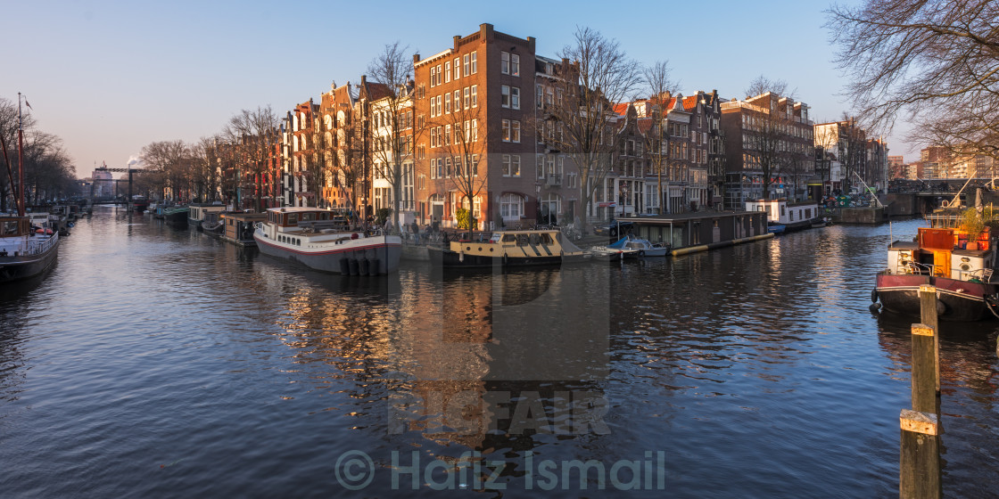 """Building Reflections at Amsterdam Canals"" stock image"