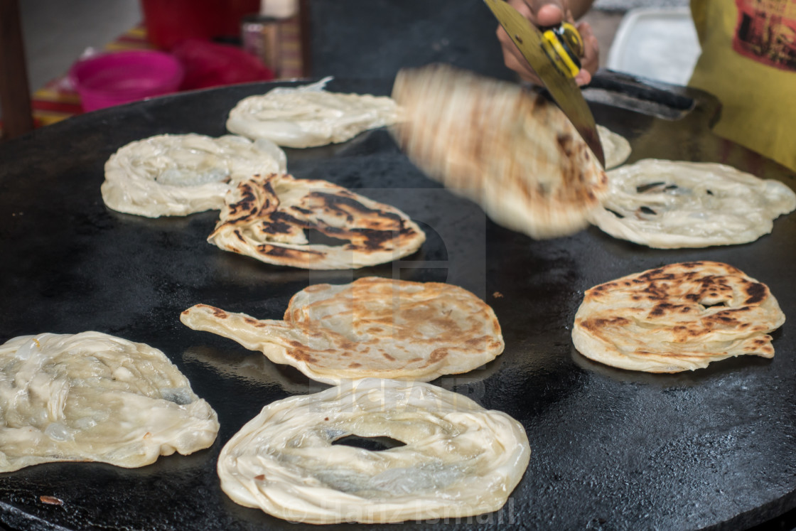 """Frying Roti Canai/Paratha"" stock image"