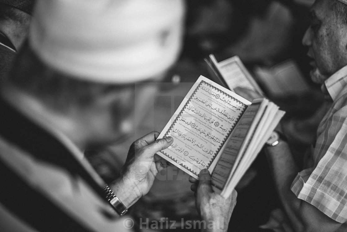 """Black & White - Muslim Men reciting/reading the Quran."" stock image"