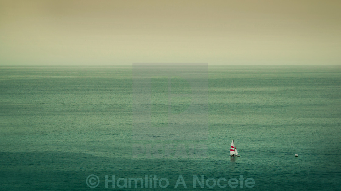"""A hazy day over the ocean"" stock image"