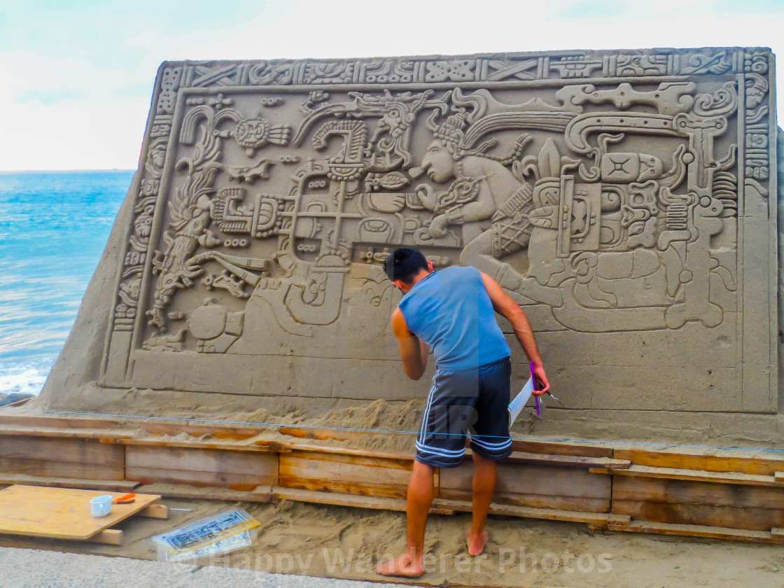 """""""Artist at work on sand mural"""" stock image"""