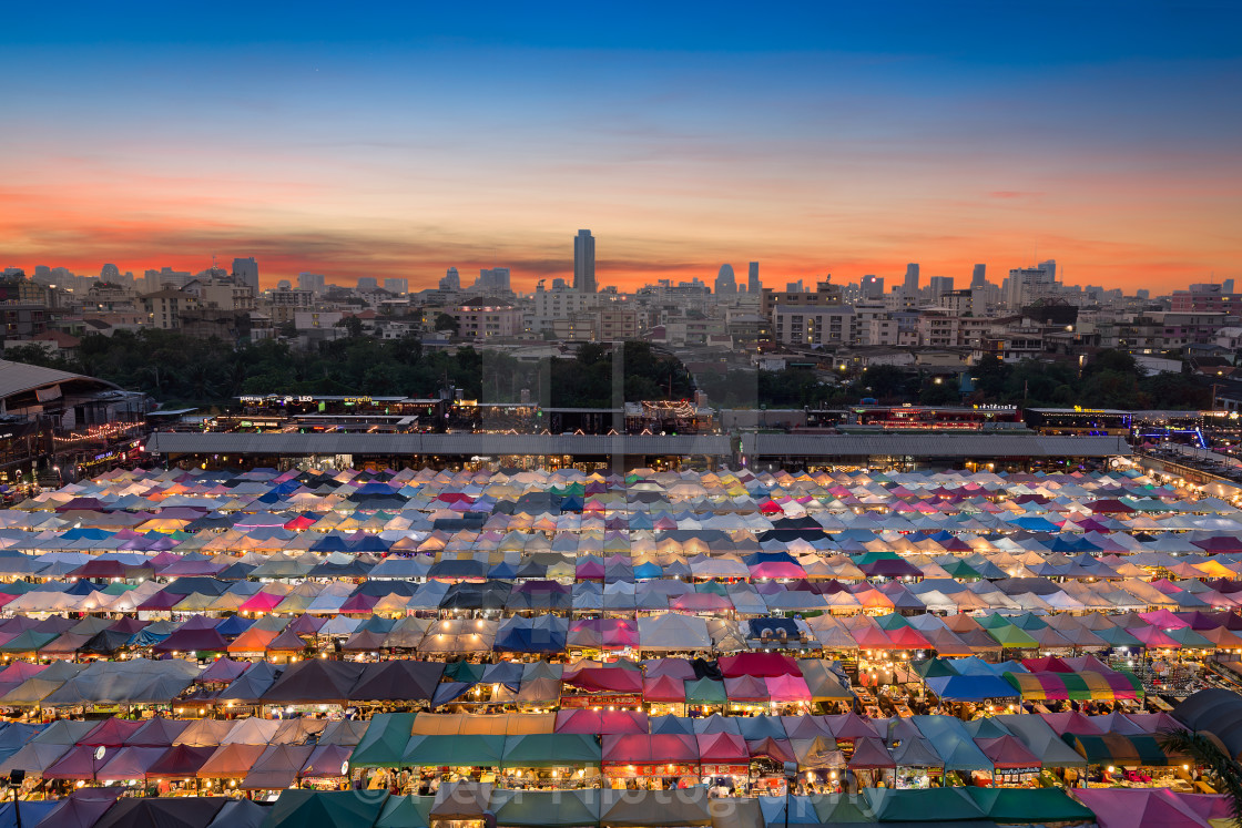 """Rot Fai Ratchada Night Market in Bangkok at Sunset"" stock image"