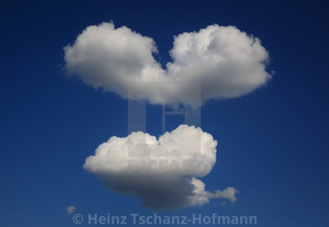 heart-shaped clouds in the sky - license for £37.20 on picfair