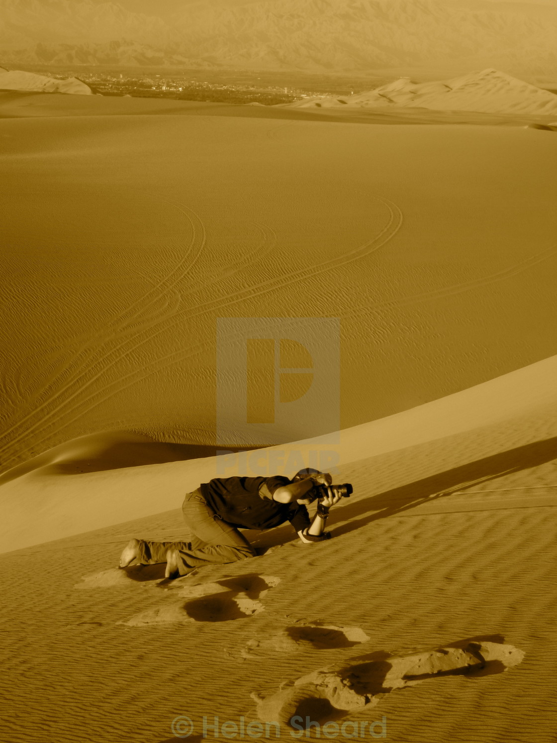 """Photographer on sand dunes"" stock image"