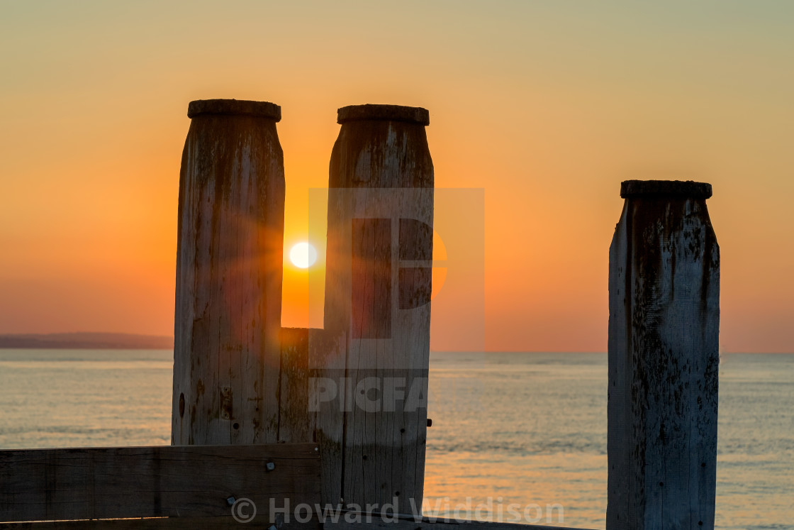 """Langney Point, Eastbourne at Sunrise"" stock image"
