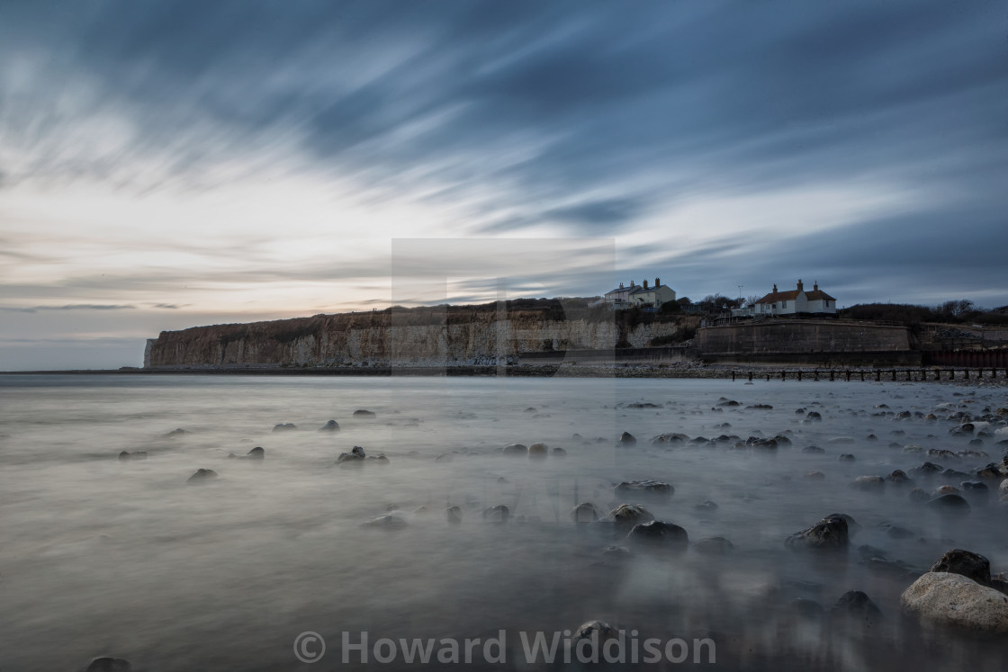 """""""Coastguard Cottages Long exposure from the advancing sea"""" stock image"""