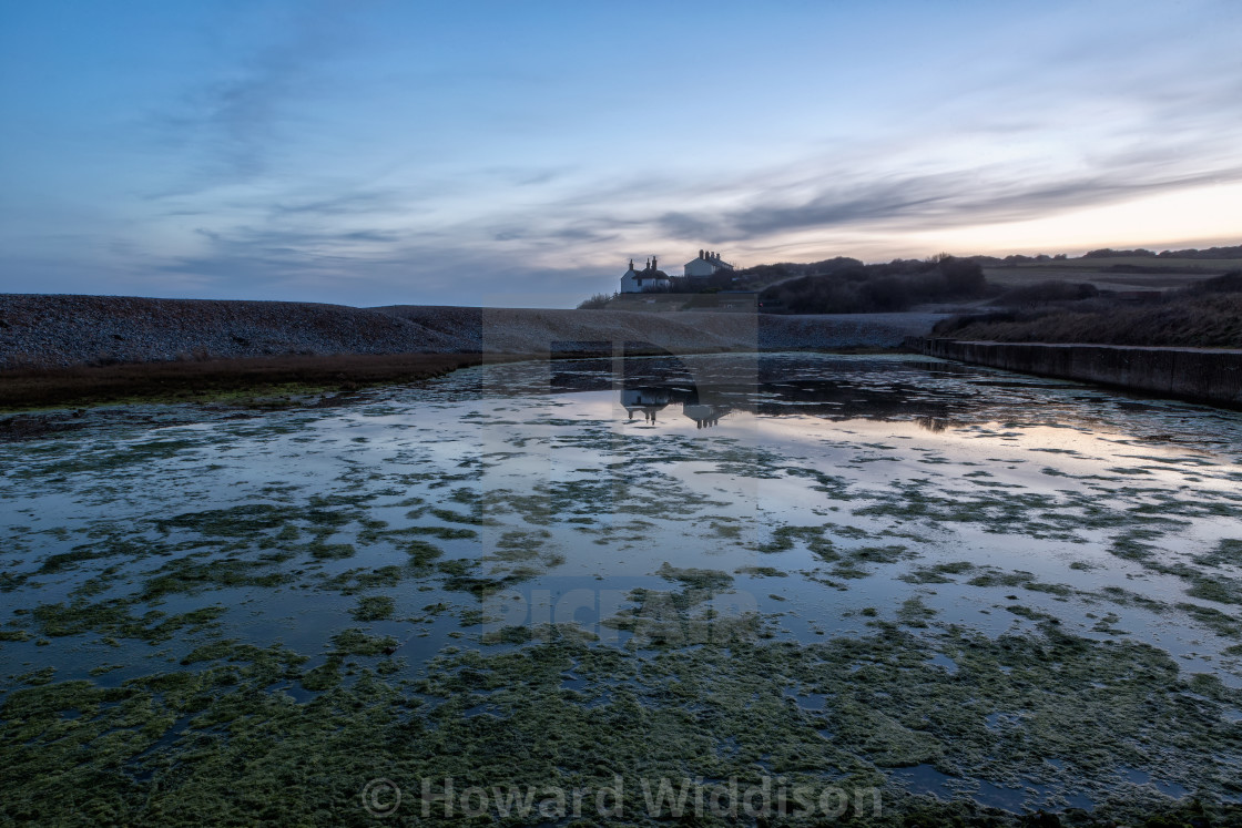 """""""Coastguard cottage reflections in the fading light."""" stock image"""