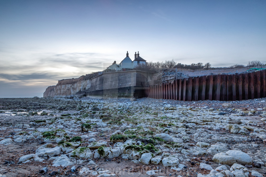 """""""Coastguard cottages from the beach in the fading light."""" stock image"""
