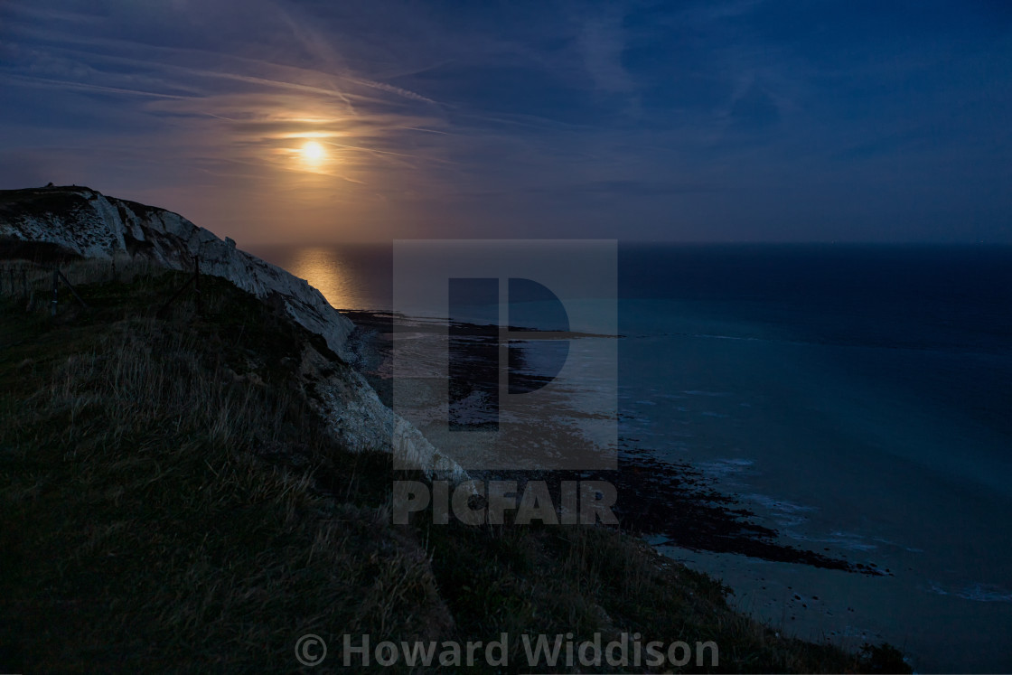 """Snow Moon from Beachy Head"" stock image"